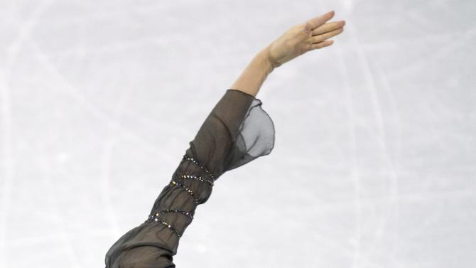 Kim Yu-na, of South Korea, performs her free program in the women's competition at the World Figure Skating Championships, Saturday, March 16, 2013, in London, Ontario. (AP Photo/The Canadian Press, Frank Gunn)