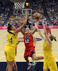 Australia&#39;s center Elizabeth Cambage, left, and forward Rachel Jarry, right, challenge United States&#39; guard Diana Taurasi during their semifinal women&#39;s basketball game at the 2012 Summer Olympics on Thursday, Aug. 9, 2012, in London. (AP Photo/Mark Ralston, Pool)