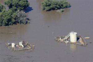 An oil well pad is surrounded by flood waters in Weld County, Colorado
