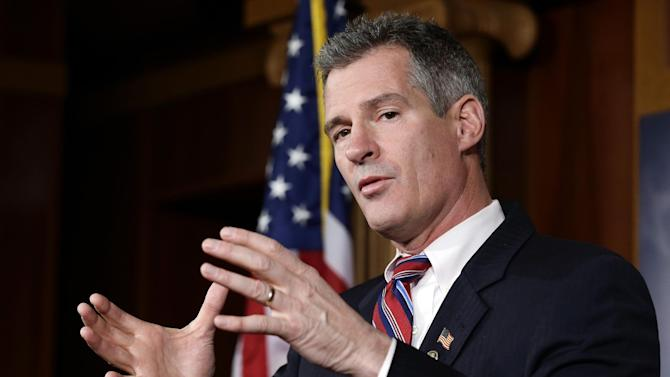 FILE - In this Nov. 13, 2012 file photo, then-Massachusetts Sen. Scott Brown speaks on Capitol Hill in Washington. Brown has begun seeking campaign staff while courting New Hampshire's political elite. The moves represent what local Republicans consider Brown's first serious steps toward launching a Senate campaign against Democratic Sen. Jeanne Shaheen. The stakes are high for the GOP's push for the Senate majority this fall and Brown's own political ambitions. (AP Photo/Alex Brandon, File)