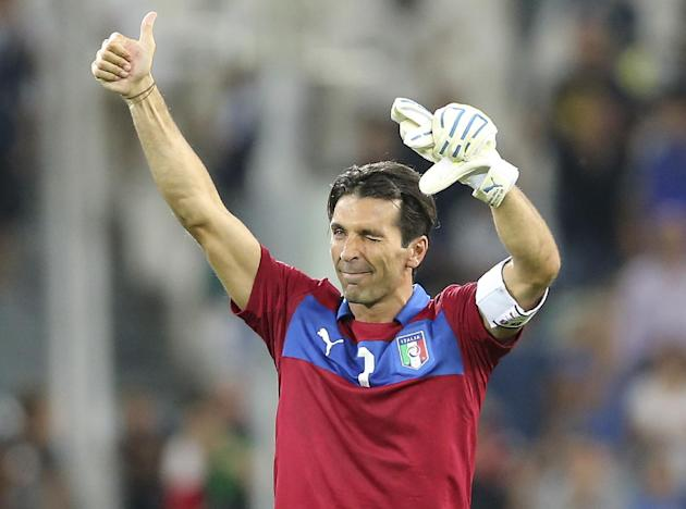 Italy goalkeeper Gianluigi Buffon waves his fan after the 2014 World Cup Group B qualifying soccer match between Italy and Czech Republic at the Juventus stadium in Turin, Italy, Tuesday, Sept. 10, 20