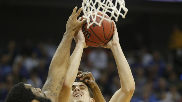 Texas forward Ioannis Papapetrou (33) tries to shoot against Kansas State guard Shane Southwell (1) and forward Thomas Gipson (42) during the first half of an NCAA college basketball game in the Big 12 tournament on Thursday, March 14, 2013, in Kansas City, Mo. (AP Photo/Orlin Wagner)