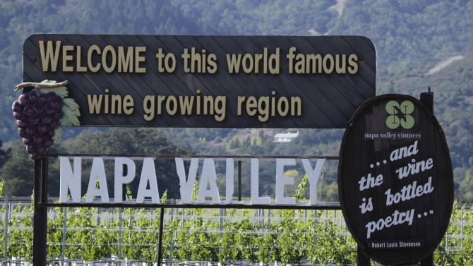 FILE - In this Oct. 27, 2011 file photo is a sign along Highway 29 welcoming visitors to the Napa Valley in Oakville, Calif. Highway 29 is a straight shot from the south end of the valley  through Napa, Yountville, Oakville, Rutherford, St. Helena and Calistoga. Along the way are dozens of restaurants and wineries, including the Robert Mondavi Winery and Inglenook, the winery restored by director Francis Ford Coppola. (AP Photo/Eric Risberg, File)