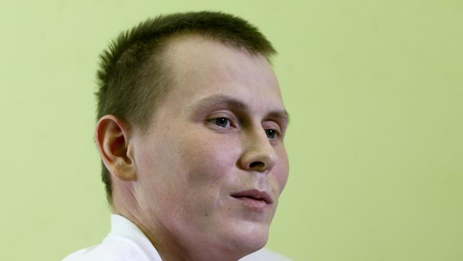 One of two Russian servicemen detained by Ukrainian forces Alexandrov answers reporter's questions at hospital in Kiev