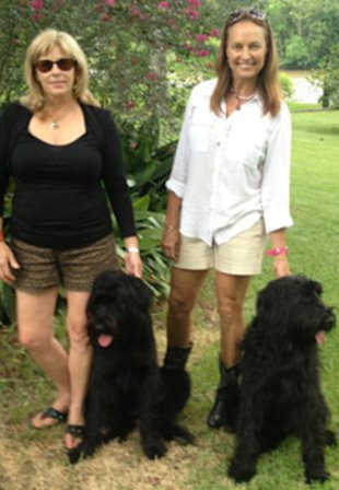 Leslie Sandlin and Barbara Conner pose with their Schnauzers.
