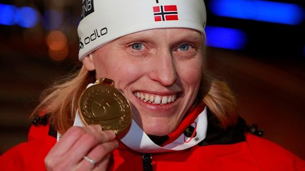 Tora Berger from Norway poses during a medal ceremony at the Biathlon World Championships in Ruhpolding March 7, 2012. Tora Berger from Norway won the women's 15 km individual race ahead