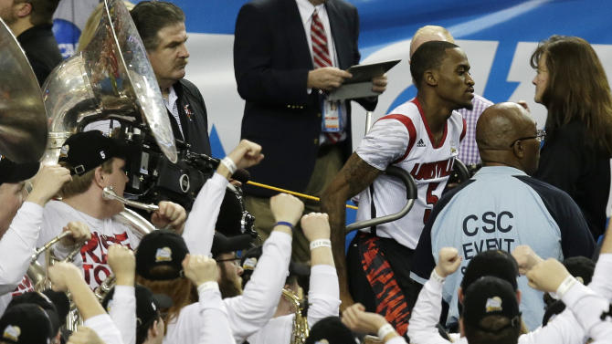 Fans cheer as Louisville's Kevin Ware takes to the court before the first half of the NCAA Final Four tournament college basketball semifinal game against Wichita State, Saturday, April 6, 2013, in Atlanta. (AP Photo/Chris O'Meara)