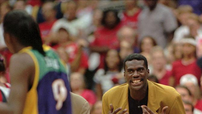 FILE - This Aug. 30, 1999 file photo shows Los Angeles Sparks' coach Orlando Woolridge reacting after he was called for a second technical foul in the second half of a WNBA Western Conference Finals game against the Houston Comets,  in Houston. Former NBA standout Orlando Woolridge has died at his parents' home in Mansfield, La. He was 52. DeSoto Parish Chief Deputy Coroner Billy Locke said Woolridge died Thursday night, May 31, 2012. He had been under hospice care for a chronic heart condition. (AP Photo/Tim Johnson, File)
