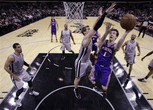 Parker powers Spurs past Suns 108-99
