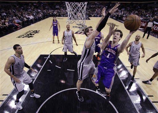 Parker powers Spurs past Suns 108-99