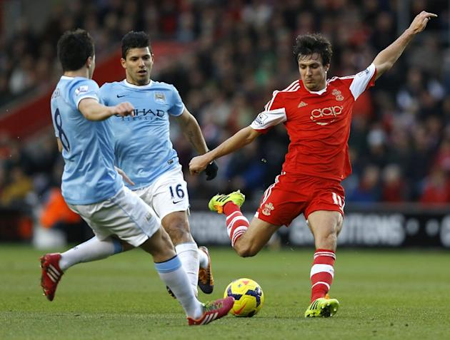 Southampton's Jack Cork, right, vies for the ball with Manchester City's Samir Nasri, left, and Sergio Aguero, center,  during the English Premier League soccer match between Southampton and M