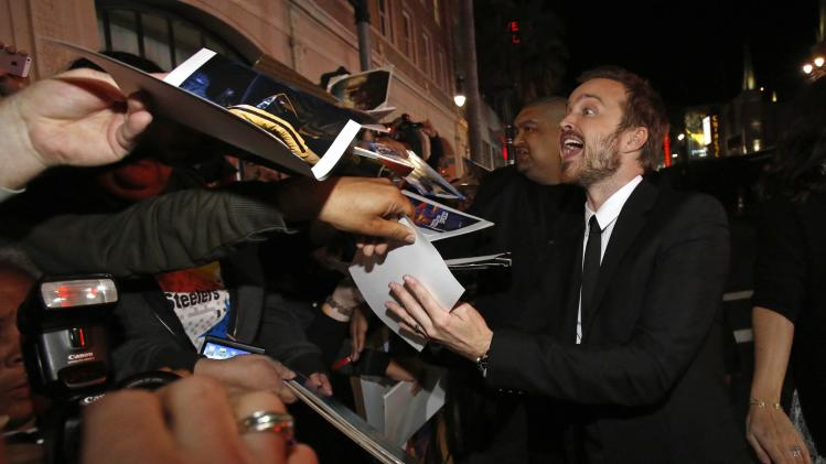 "Cast member Aaron Paul signs autographs at the premiere of ""Need for Speed"" at the TCL Chinese theatre in Hollywood"