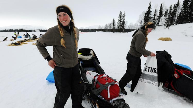 Kristy Berington, left, and twin sister Anna Berington, right, pack up their sleds as they prepare to leave the Finger Lake checkpoint in Alaska during the Iditarod Trail Sled Dog Race on Monday, Mar. 4, 2013. (AP Photo/The Anchorage Daily News, Bill Roth)