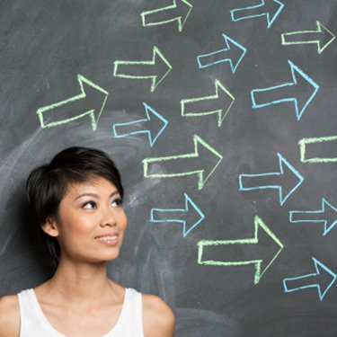 Asian-woman-standing-in-front-of-chalk-drawn-arrows_web