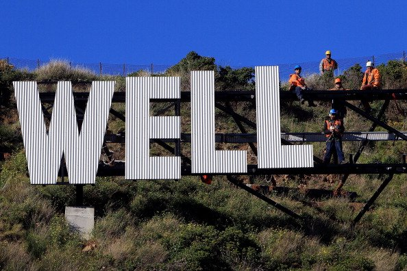 Workers install Wellington Airport's 'Wellington Blown Away' sign on July 27, 2012 in Wellington, New Zealand. The city was originally planning to put up a 'Wellywood' sign in 2010 to promote the loca
