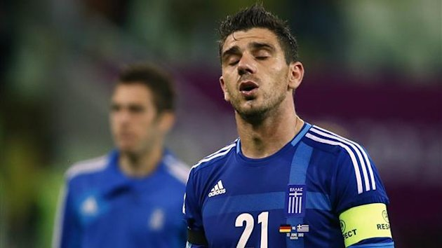 Greece's Kostas Katsouranis reacts at the end of their Euro 2012 quarter-final match against Germany (Reuters)