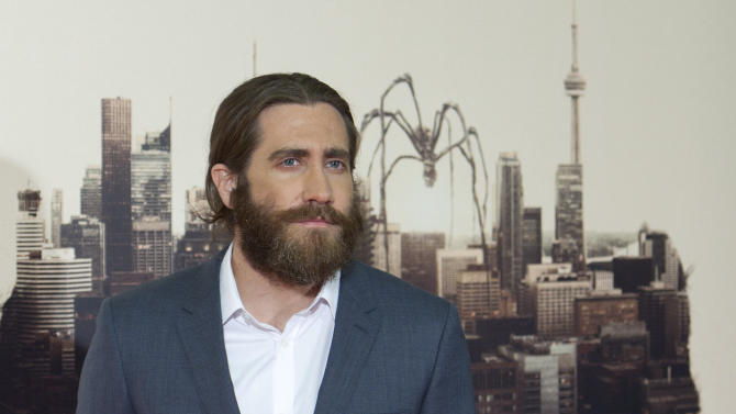 """FILE - In this March 20, 2014 file photo, US actor Jake Gyllenhaal poses for the photographers during the Spain Premiere of the movie """"Enemy"""" in Madrid, Spain. Gyllenhaal will make his Broadway debut later this year with a work by a playwright he's come to admire. The Manhattan Theatre Club said Thursday, June 12, 2014, the """"Brokeback Mountain"""" star will appear in Nick Payne's """"Constellations,"""" which has been a hit in London. (AP Photo/Abraham Caro Marin, file)"""