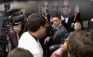 "In this video image taken from AP video U.S. actor Will Smith, center right, walks away from reporter Vitalii Sediuk, white suit, from the Ukrainian television channel 1+1 after slapping him on the red carpet before the premiere of ""Men in Black III"" Friday May 18, 2012 in Moscow. Hollywood star Will Smith has slapped a male television reporter who tried to kiss him before the Moscow premiere of ""Men in Black III."" Smith pushed him away and then slapped him lightly across the cheek with the back of his left hand. (AP Photo via AP video)"
