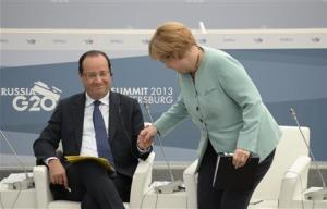 German Chancellor Merkel and French President Hollande attend a meeting with business leaders in St.Petersburg
