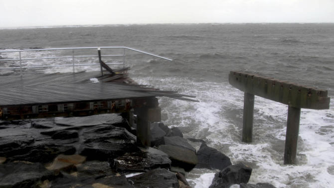 Large stretches of boardwalk were destroyed by Storm Sandy in Atlantic City, N.J., Tuesday, Oct. 30, 2012.  Sandy, the storm that made landfall Monday, caused multiple fatalities, halted mass transit and cut power to more than 6 million homes and businesses. (AP Photo/Seth Wenig)
