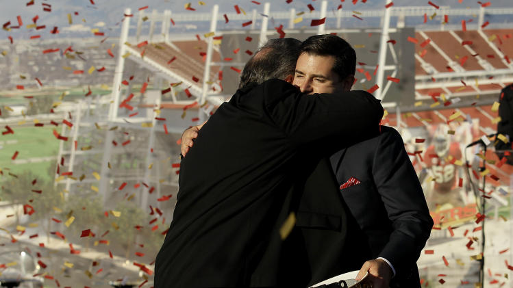 San Francisco 49ers owner Jed York, right, hugs Santa Clara Mayor Jamie Matthews at a groundbreaking ceremony at the construction site for the 49ers' new NFL football stadium in Santa Clara, Calif., Thursday, April 19, 2012. (AP Photo/Jeff Chiu)