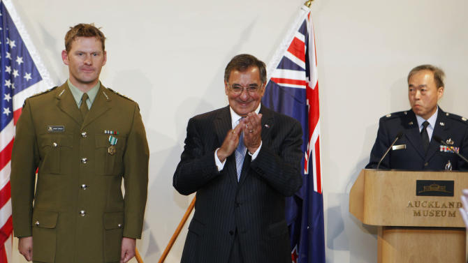 U.S. Secretary of Defense Leon Panetta applauds after presenting New Zealand Army Capt. Jason Tinsley, left, a U.S. Army Commendation Medal for his service in Afghanistan, in the auditorium at the World War II Hall of Memories at the Auckland War Memorial Museum in Auckland, New Zealand, Friday, Sept. 21, 2012. (AP Photo/Larry Downing, Pool)