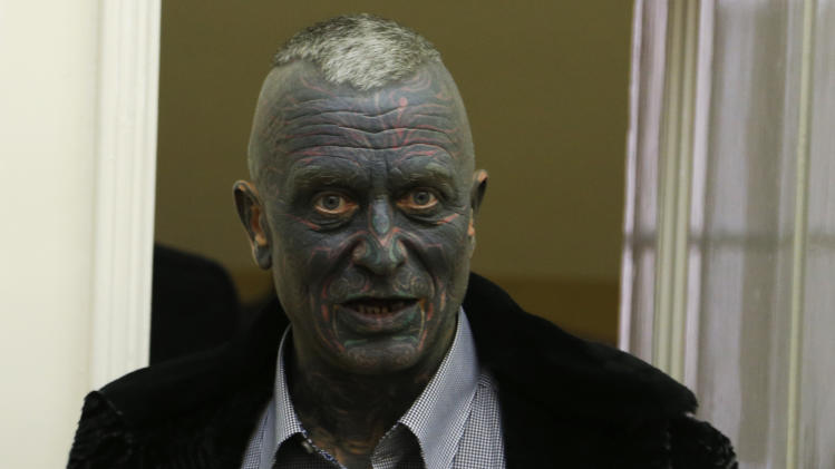 Presidential candidate Vladimir Franz arrives to cast his vote for presidential elections at a polling station in Prague, Czech Republic, Friday, Jan. 11, 2013. (AP Photo/Petr David Josek)