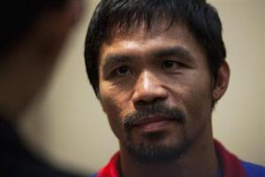 Boxer Pacquiao of the Philippines looks on during a news conference at the Venetian Macao hotel in Macau