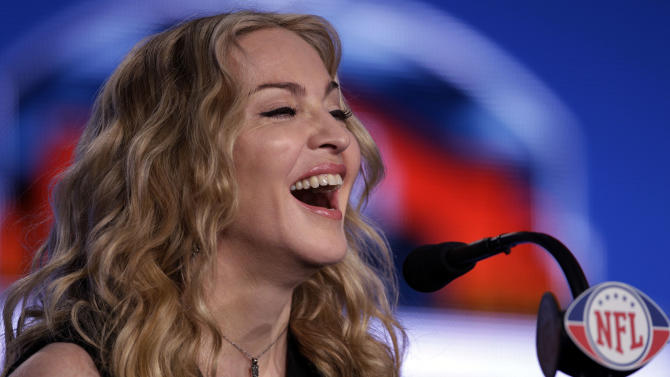 Madonna speaks during a news conference for NFL footbal's Super Bowl XLVI's halftime show Thursday, Feb. 2, 2012, in Indianapolis. (AP Photo/Matt Slocum)