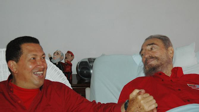 FILE - In this Aug. 13, 2006 file photo released by Cuba's Communist daily newspaper Granma, Cuba's leader Fidel Castro, right, and Venezuela's President Hugo Chavez hold hands as Castro recuperates from surgery in Havana, Cuba. Venezuela's Vice President Nicolas Maduro announced on Tuesday, March 5, 2013 that Chavez has died at age 58 after a nearly two-year bout with cancer. (AP Photo/Granma, File)