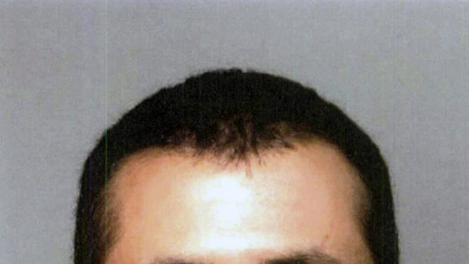 "FILE - This file booking photo provided by the Seminole County Sheriff's Office shows George Zimmerman. The former neighborhood watch volunteer who killed Trayvon Martin told his wife to buy bulletproof vests for them and for his attorney, according to jailhouse calls released Monday, June 18, 2012. ""As uncomfortable as it is, I want you wearing one,"" George Zimmerman told his wife. (AP Photo/Seminole County Sheriff's Office, File)"