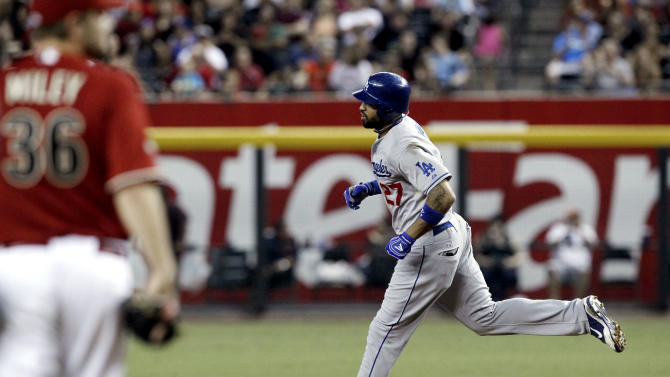 Los Angeles Dodgers' Matt Kemp, right, rounds the bases after hitting a two-run home run against Arizona Diamondbacks' Wade Miley (36) during the seventh inning of a baseball game Wednesday, Sept. 28, 2011, in Phoenix. (AP Photo/Ross D. Franklin)