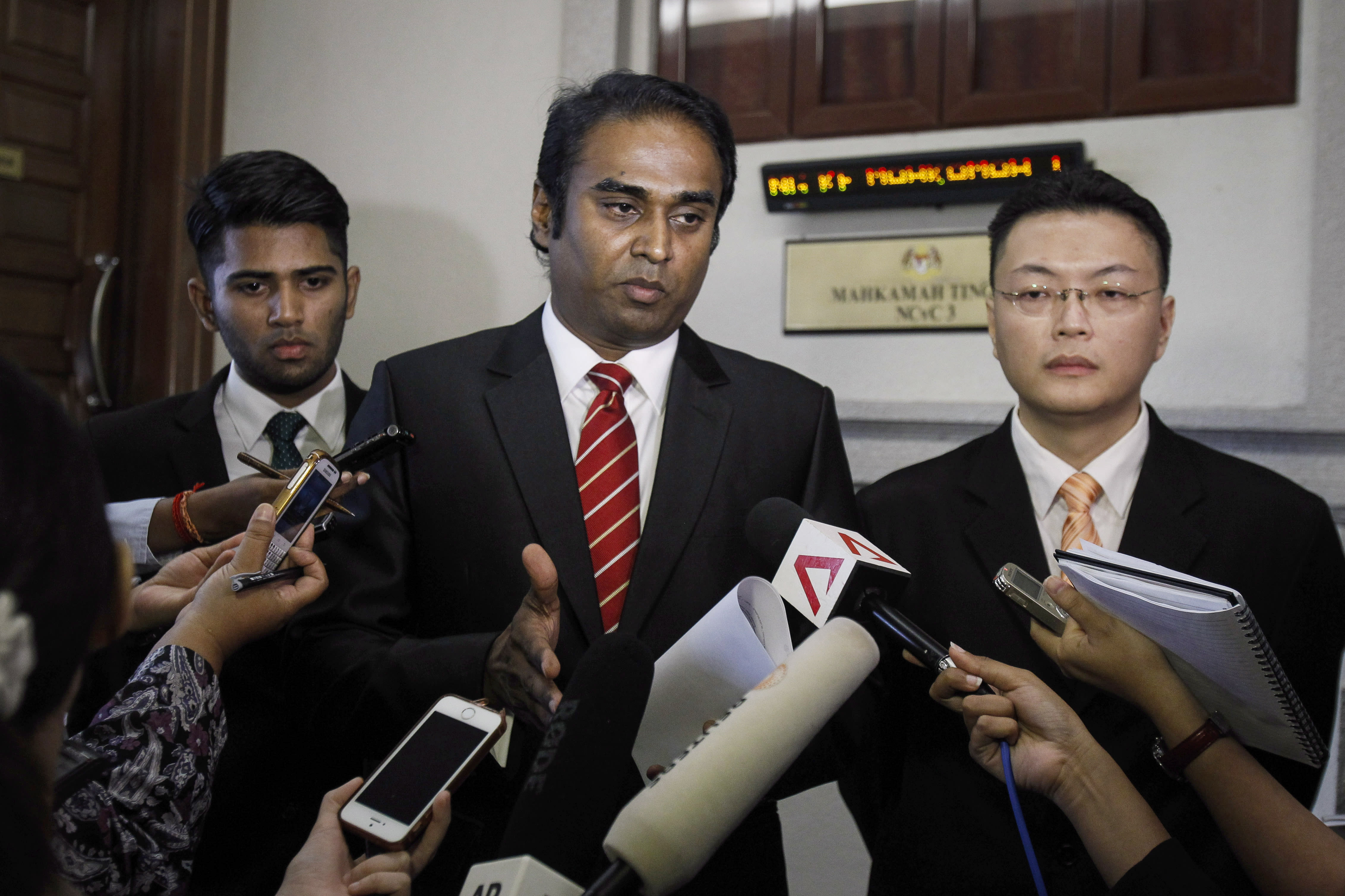 Malaysian brothers get settlement in Flight 370 law suit