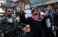 Syrians carry the body of a fighter during a funeral after Friday prayer in the northeastern city of Aleppo on February 15, 2013