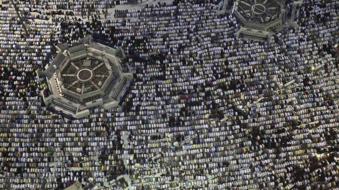 Muslim pilgrims pray at Grand mosque in Mecca, ahead of annual haj pilgrimage