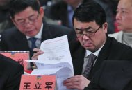 Wang Lijun reads documents as he attends a session of the Chinese People's Political Consultative Conference (CPPCC) of the Chongqing Municipal Committee, in Chongqing municipality in this January 7, 2012 file photo. REUTERS/Stringer/Files