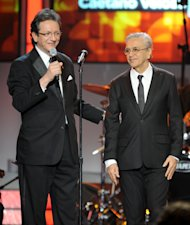 Gabriel Abaroa, left, president and CEO of the Latin Academy of Recording Arts and Sciences, is seen on stage with Caetano Veloso after the presentation of the 2012 Latin Recording Academy Person of the Year award at the MGM Grand Garden Arena on Wednesday, Nov. 14, 2012, in Las Vegas. (Photo by Powers Imagery/Invision/AP)