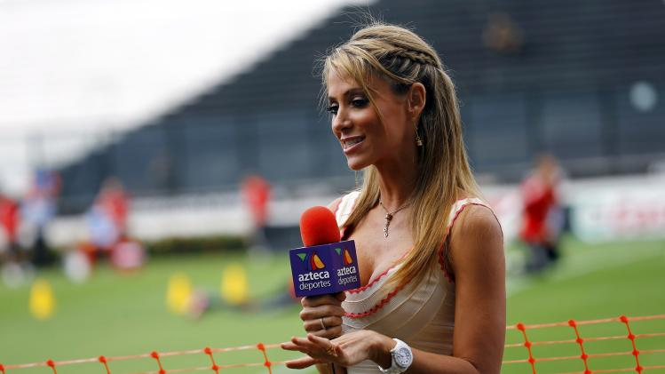 A sports reporter of Mexican television station TV Azteca reports from Germany's training session in Rio de Janeiro