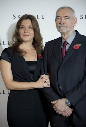"""FILE - In this Nov. 3, 2011 file photo, producers Barbara Broccoli, left, and Michael G. Wilson pose for photographs at a photo-call for the new James Bond film, """"Skyfall,"""" at a central London restaurant venue. The film is the 23rd in the Bond series. With """"Skyfall,"""" which premieres Oct. 23, 2012 in London, the family made another tough choice: casting 31-year-old Ben Whishaw as Bond's gadget guru, Q.  (AP Photo/Joel Ryan, File)"""