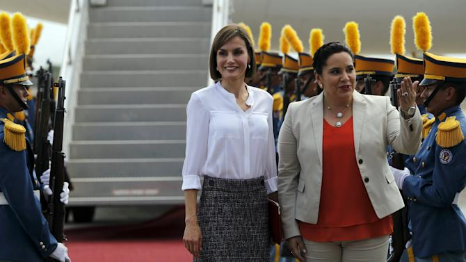 Spain's Queen Letizia stands with Honduras' first lady Ana Garcia de Hernandez after her arrival at Palmerola Air Base in Comayagua, Honduras