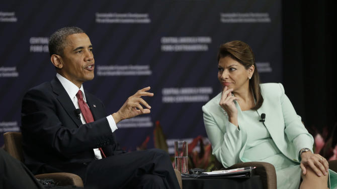 U.S. President Barack Obama and Costa Rica's President Laura Chinchilla, right, participate in a forum on Inclusive Economic Growth and Development at the Old Custom House in San Jose, Costa Rica, Saturday, May 4, 2013. (AP Photo/Pablo Martinez Monsivais)