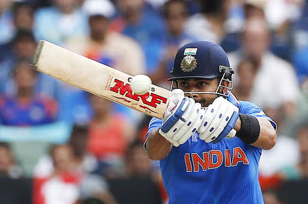 India's Virat Kohli hits a shot during the Cricket World Cup match against South Africa at the Melbourne Cricket Ground (MCG)