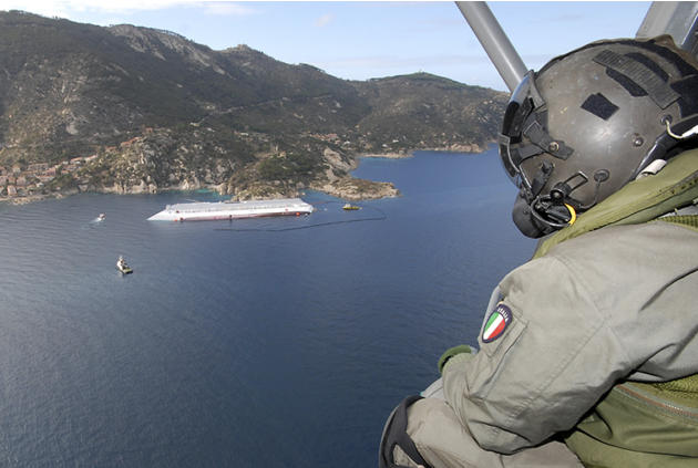 In this undated photo released by the Italian Navy Thursday, Jan. 26, 2012, the Costa Concordia cruise ship is seen grounded off the Tuscan island of Giglio, Italy. Italian authorities have identified