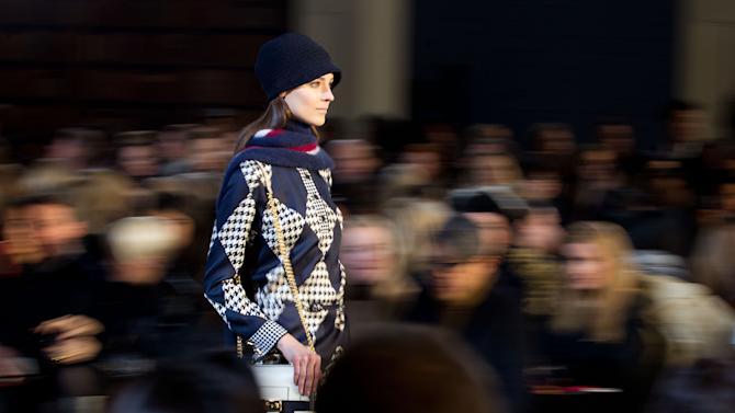 A model walks the runway at the Fall 2013 Tommy Hilfiger show, on Sunday, Feb., 10, 2013 in New York. (Photo by Dario Cantatore/Invision/AP)