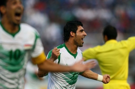 Iraq's Hammadi Ahmed Abdullah (R) and Younus Mahmood celebrate after scoring during a Gulf Cup match on January 9, 2013. Iraq will take on the United Arab Emirates in the final of the 21st Gulf Cup on Friday after both sides advanced through the group stage undefeated