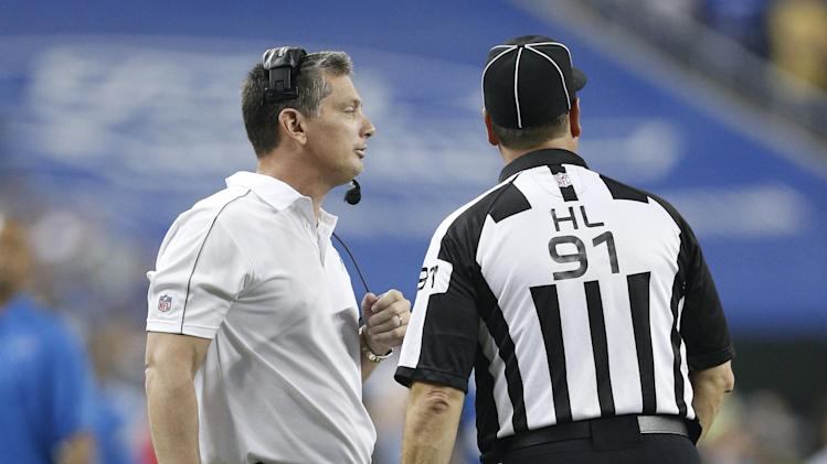 Detroit Lions head coach Jim Schwartz talks with head linesman Jerry Bergman (91) during overtime of an NFL football game against the Houston Texans at Ford Field in Detroit, Thursday, Nov. 22, 2012. (AP Photo/Rick Osentoski)