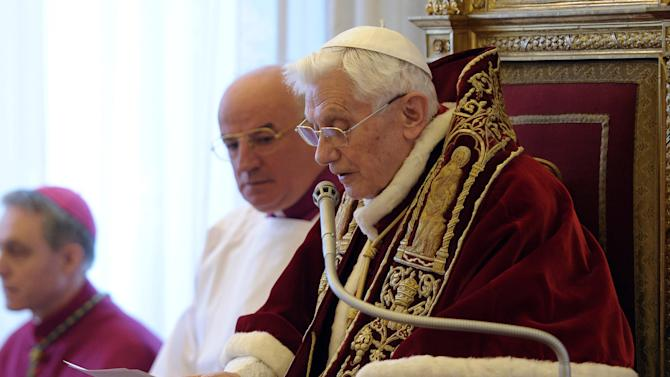 In this photo provided by the Vatican newspaper L'Osservatore Romano, Pope Benedict XVI reads a document in Latin where he announces his resignation, during a meeting of Vatican cardinals, at the Vatican, Monday, Feb. 11, 2013. Benedict XVI announced Monday that he would resign Feb. 28 - the first pontiff to do so in nearly 600 years. The decision sets the stage for a conclave to elect a new pope before the end of March. (AP Photo/L'Osservatore Romano, ho)
