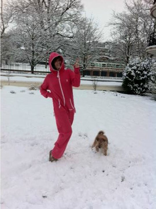 Celebs in the snow: Amanda Holden played in the snow in the best way possible - wearing her onesie. Copyright [Amanda Holden]