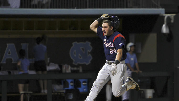 Florida Atlantic's Tyler Rocklein celebrates a grand slam in the top of the ninth inning that put the team ahead of North Carolina at the NCAA college baseball tournament regional in Chapel Hill, N.C., Monday, June 3, 2013. North Carolina tied the game in the bottom of the ninth. (AP Photo/Ted Richardson)