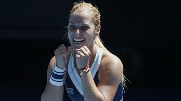 Dominika Cibulkova of Slovakia celebrates defeating Simona Halep of Romania (Reuters)